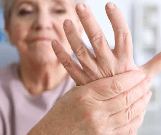 Elderly woman holding hand