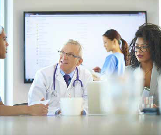 Healthcare professionals in a meeting at a desk